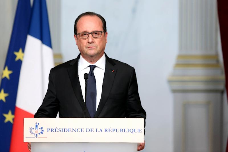 In this picture received from the French Presidents office French president Francois Hollande addresses the nation on November 13, 2015 after a series of gun attacks occurred across Paris