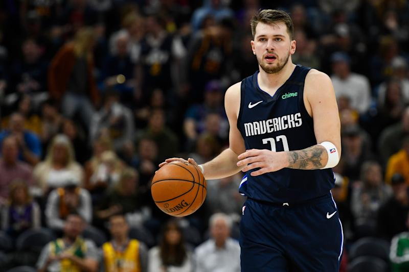 After rolling his ankle in practice, Luka Doncic will miss at least six games for Dallas. (Alex Goodlett/Getty Images)