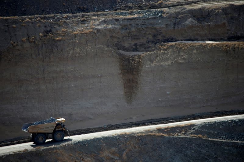 FILE PHOTO: A mining truck takes ore from the open-pit mine at the MP Materials rare earth mine in Mountain Pass