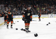 Anaheim Ducks' Ondrej Kase, center, smiles after scoring his third goal of the game for a hat trick during the third period of an NHL hockey game against the Dallas Stars, Wednesday, Dec. 12, 2018, in Anaheim, Calif. (AP Photo/Marcio Jose Sanchez)