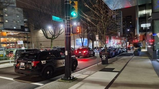 Numerous Vancouver police vehicles converge on the street where police raided a penthouse party at Movassaghi's home last January.