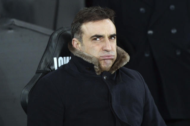 Swansea City manager Carlos Carvalhal reacts before the game against Notts County, during the Emirates FA Cup, fourth round replay match at the Liberty Stadium in Swansea, England, Tuesday Feb. 6, 2018. (Simon Galloway/PA via AP)