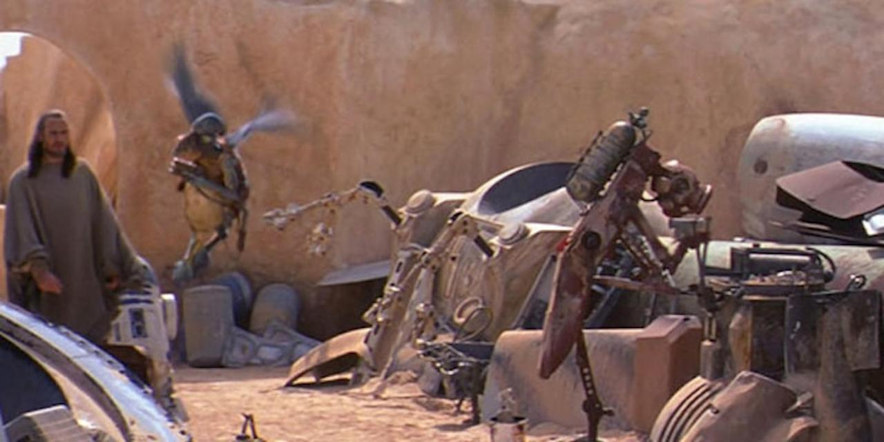 As Qui-Gon walks into Watto's junkyard, you can see an old EVA Pod from 2001: A Space Odyssey. It's the orb structure with the large round hole near the center of the image.