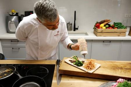 Chef prepares a dish including a piece of lab-grown steak produced from cow cells in Rehovot, Israel