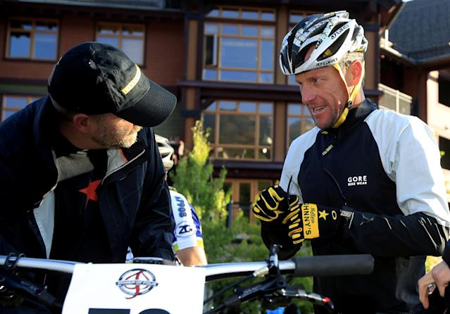 Lance Armstrong, center, prepares to take part in the Power of Four mountain bicycle race at the starting line in Snowmass Village, Colo., early Saturday, Aug. 25, 2012. The race is the first public appearance for Armstrong since the U.S. Anti-Doping Association stripped him of his seven Tour de France championships and banned him for life from the sport. (AP Photo/David Zalubowski)