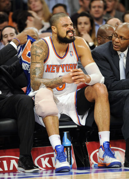 New York Knicks' Tyson Chandler sits on the bench with his knee wrapped after being injured during the first quarter of an NBA basketball game against the Charlotte Bobcats on Tuesday, Nov. 5, 2013, at Madison Square Garden in New York. (AP Photo/Bill Kostroun)