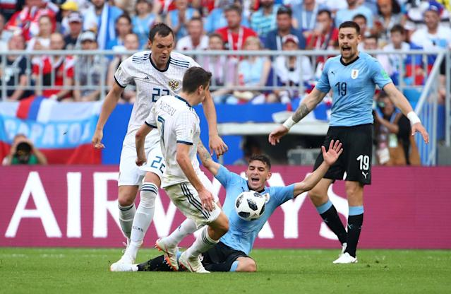 Soccer Football - World Cup - Group A - Uruguay vs Russia - Samara Arena, Samara, Russia - June 25, 2018 Uruguay's Lucas Torreira appeals for a foul after a challenge from Russia's Daler Kuzyayev REUTERS/Michael Dalder