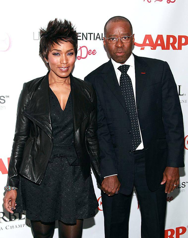 "NEW YORK, NY - NOVEMBER 14:  Actress Angela Bassett and actor Courtney Vance attend the ""Life's Essentials With Ruby Dee"" screening at The Schomburg Center for Research in Black Culture on November 14, 2012 in New York City.  (Photo by Taylor Hill/Getty Images)"
