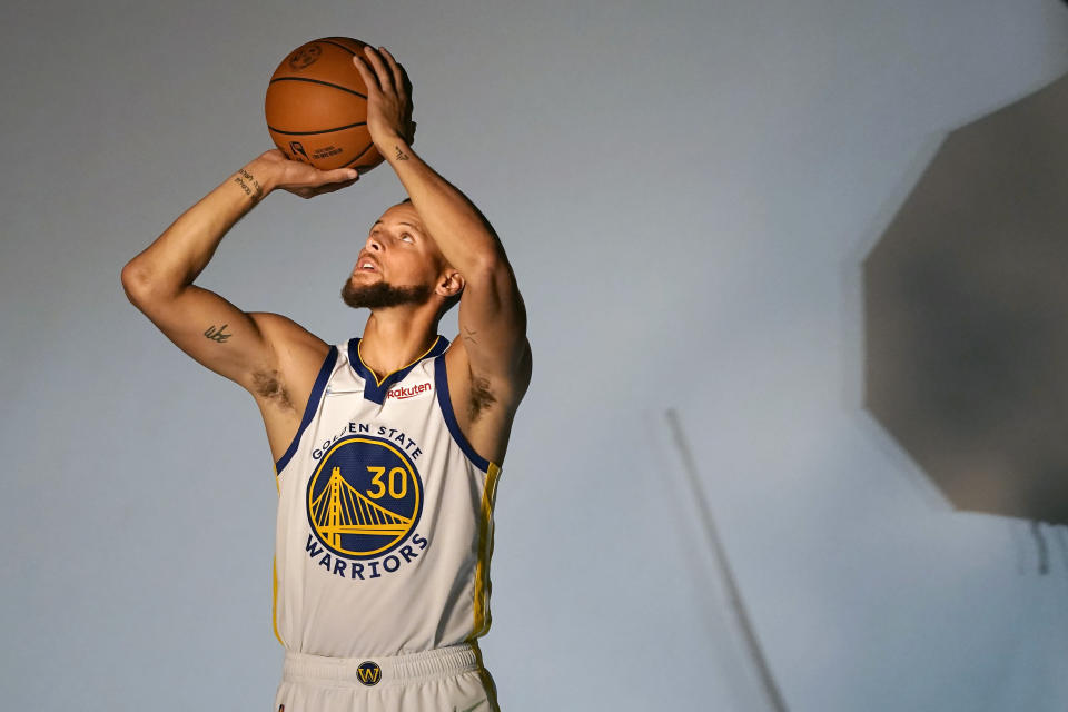 Golden State Warriors guard Stephen Curry poses for photos during the NBA basketball team's media day in San Francisco, Monday, Sept. 27, 2021. (AP Photo/Jeff Chiu)