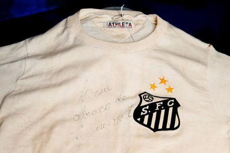 An autographed shirt wore by Pele during a match between Santos and Chelsea in 1971 is displayed by Julien's Auctions in New York City, U.S., December 1, 2016. REUTERS/Brendan McDermid