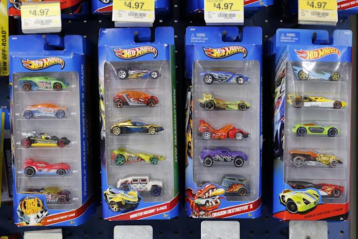 In this Tuesday, Jan. 28, 2014, photo, Hot Wheels cars, a Mattel product, are displayed in a Walmart store in Robinson Township, Pa. Mattel Inc. reports quarterly financial results before the market open on Friday, Jan. 31, 2014. (AP Photo/Gene J. Puskar)
