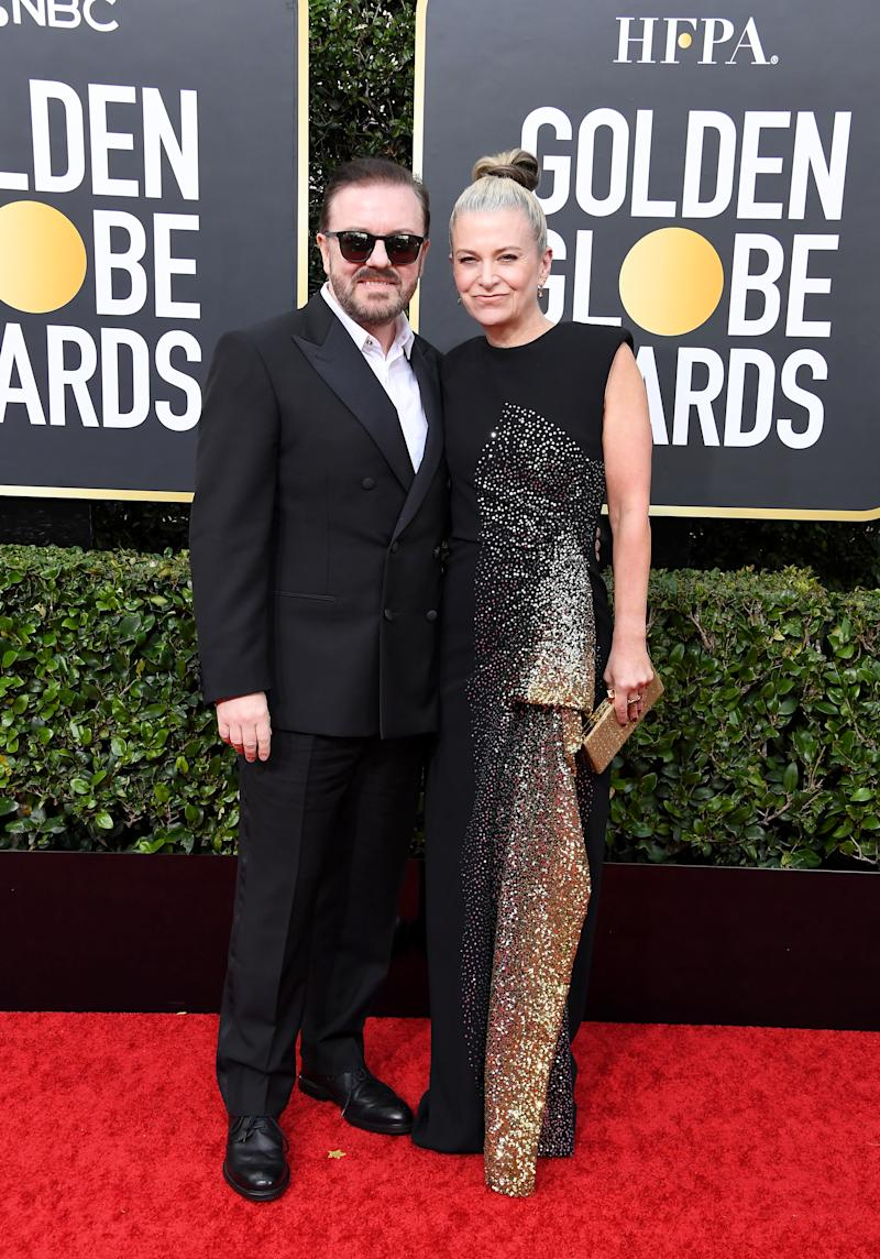 Ricky Gervais and Jane Fallon pose for photographers at the Golden Globes