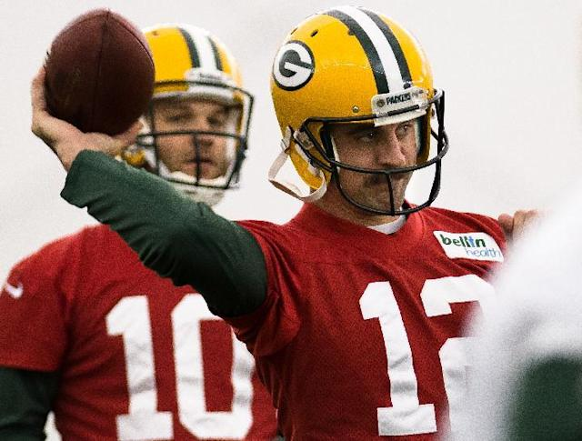 Green Bay Packers NFL football quarterback Aaron Rodgers (12) practices in Ashwaubenon, Wisc., on Tuesday, Nov. 26, 2013. (AP Photo/The Green Bay Press-Gazette, Lukas Keapproth)