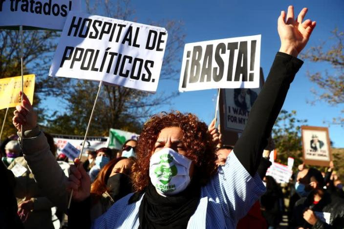 Health workers protest outside the Enfermera Isabel Zendal new hospital during its inauguration, amid the coronavirus disease (COVID-19) outbreak, in Madrid