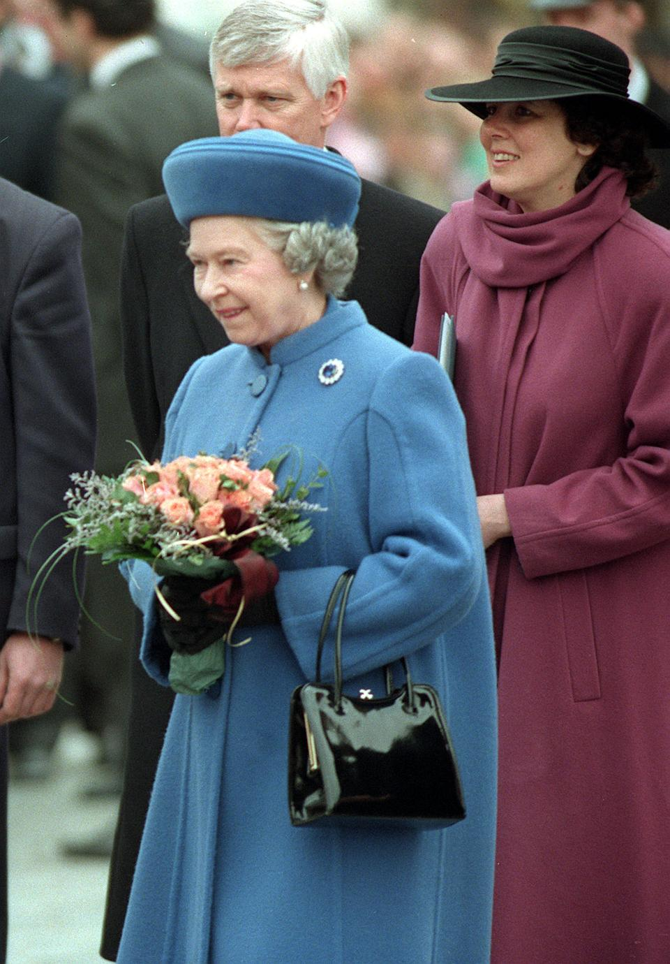 The Queen meets Czechs during her visit to Prague, their capital. The Queen and the Duke of Edinburgh later left the Czech Republic after a  three day visit. The Queen is wearing the Prince Albert Brooch, crafted from Diamonds and a large Sapphire, a gift from Prince Albert of Saxe-Coburg-Gotha to Queen Victoria on the eve of their wedding in 1840.   (Photo by John Stillwell - PA Images/PA Images via Getty Images)
