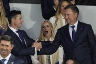 Team Europe's Rory McIlroy shakes hands with Team Europe's Ian Poulter after it was announced they would play together in Friday's foursomes during the opening ceremony for the Ryder Cup at the Whistling Straits Golf Course Thursday, Sept. 23, 2021, in Sheboygan, Wis. (AP Photo/Charlie Neibergall)