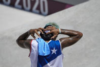 Manny Santiago of Puerto Rico cools off after competing in the men's street skateboarding at the 2020 Summer Olympics, Sunday, July 25, 2021, in Tokyo, Japan. (AP Photo/Jae C. Hong)