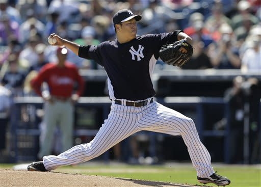 New York Yankees starting pitcher Hiroki Kuroda (18) delivers in the first inning of the Yankees spring training baseball game against the Philadelphia Phillies at Steinbrenner Field in Tampa, Fla., Saturday, March 16, 2013. Kuroda allowed four runs on six hits, including a three-run home run to the Phillies' Domonic Brown. (AP Photo/Kathy Willens)