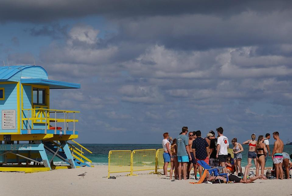 MIAMI BEACH, FLORIDA - MARCH 16: People enjoy themselves on the beach on March 16, 2021 in Miami Beach, Florida. College students have arrived in the South Florida area for the annual spring break ritual. City officials are concerned with large spring break crowds as the coronavirus pandemic continues. They are advising people to wear masks if they cannot social distance.  (Photo by Joe Raedle/Getty Images)