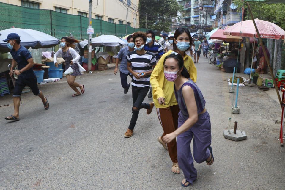 Anti-coup protesters run after seeing police and soldiers arrive to disperse their demonstration in Yangon, Myanmar, Tuesday, April 27, 2021. Demonstrations have continued in many parts of the country since Saturday's meeting of leaders from the Association of Southeast Asian Nations, as have arrests and beatings by security forces despite an apparent agreement by junta leader Senior Gen. Min Aung Hlaing to end the violence. (AP Photo)