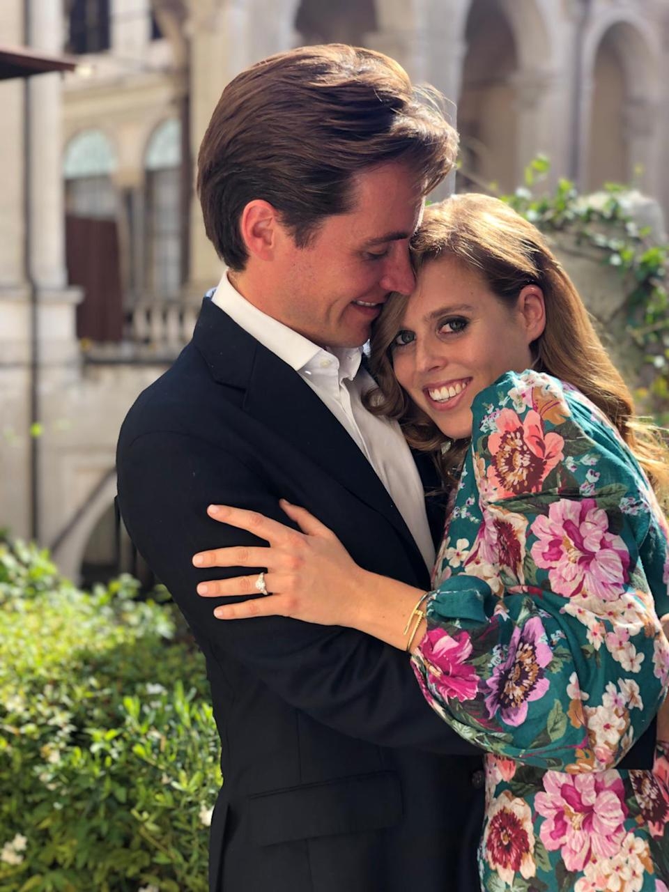 Princess Beatrice and Mr Edoardo Mapelli Mozzi pose together as their engagement is announced.