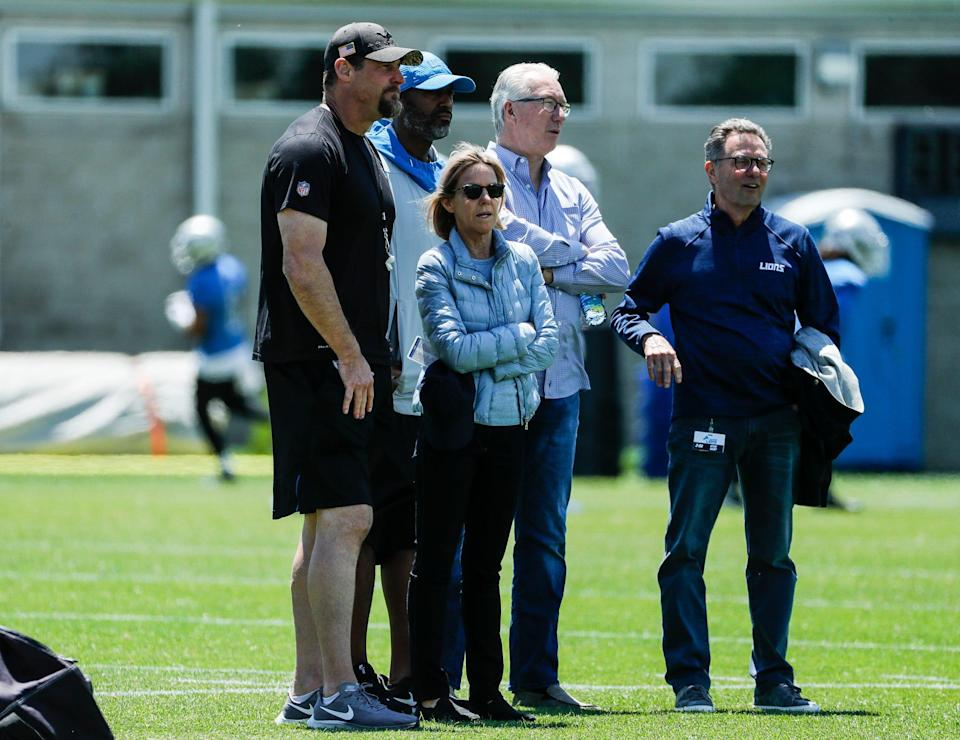 From left, Detroit Lions head coach Dan Campbell, general manager Brad Holmes, owner Sheila Ford Hamp, president Rod Wood and Steve Hamp watch practice during organized team activities at Lions headquarters in Allen Park, Thursday, May 27, 2021.