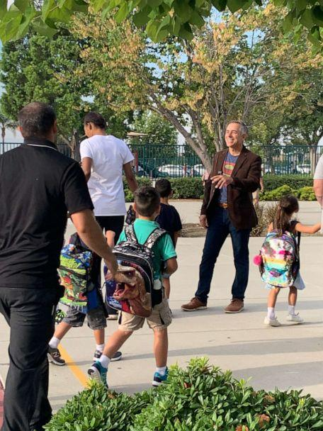 PHOTO: Jeff Sipos kicked off the new school year Aug. 5 by exchanging hugs and high fives with pupils and their families outside John L. Golden Elementary School in Rancho Cucamonga, California. (Liza Chu/John L. Golden Elementary School)