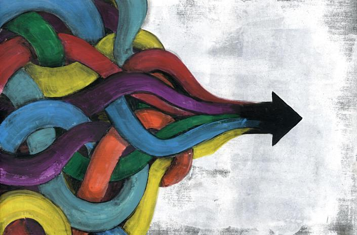 Image of multicolored, complicated, twisted threads combining to form a single arrow against a light gray backdrop.