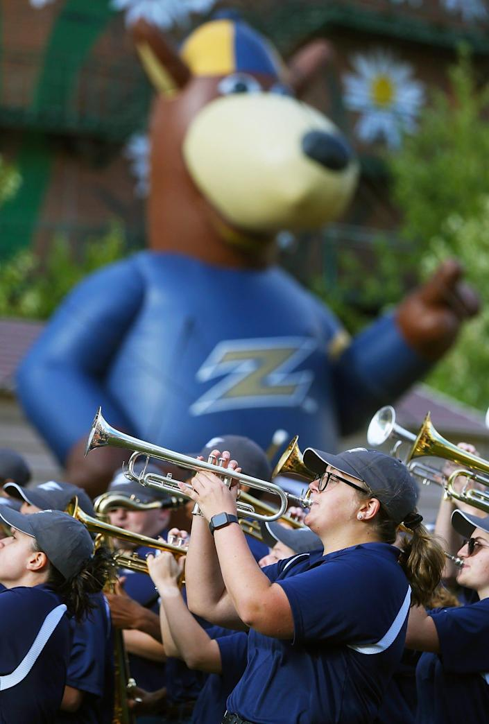 A giant inflatable Zippy appears to watch as the University of Akron marching band performs at Lock 3 Park, Tuesday, Sept. 7, 2021, in Akron, Ohio.