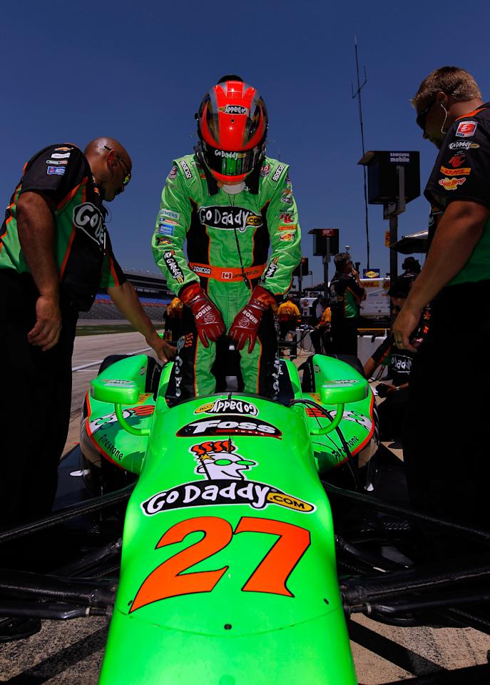 FORT WORTH, TX - JUNE 08:  James Hinchcliffe of Canada, driver of the #27 Team GoDaddy.com Chevrolet Dallara , prepares for practice for the IZOD IndyCar Series Firestone 550 at Texas Motor Speedway on June 8, 2012 in Fort Worth, Texas.  (Photo by Tom Pennington/Getty Images for Texas Motor Speedway)