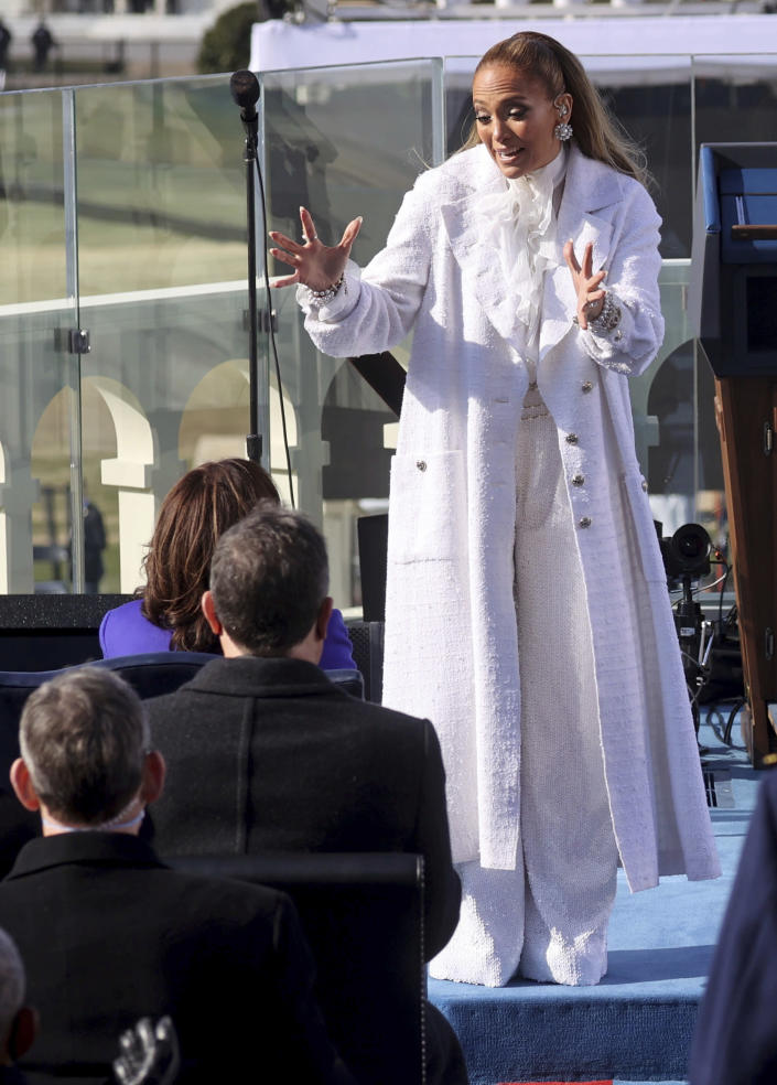 Singer Jennifer Lopez greets Vice President-elect Kamala Harris during President-elect Joe Biden's inauguration, Wednesday, Jan. 20, 2021, at the U.S. Capitol in Washington. (Jonathan Ernst/Pool Photo via AP)