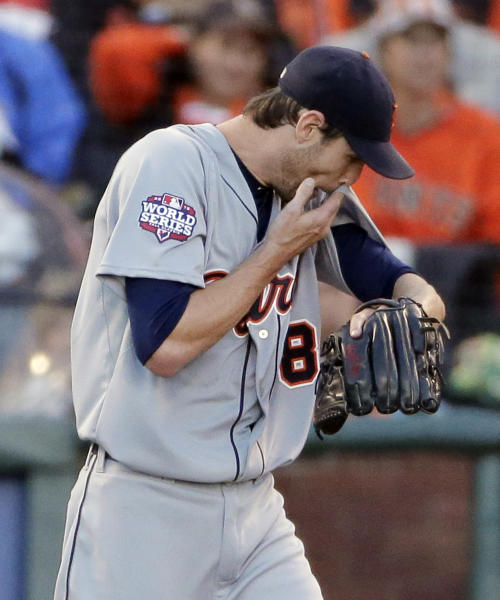 Detroit Tigers' Doug Fister reacts after being hit in the head on a hit by San Francisco Giants' Gregor Blanco during the second inning of Game 2 of baseball's World Series Thursday, Oct. 25, 2012, in San Francisco. Fister stayed in the game. (AP Photo/Charlie Riedel)