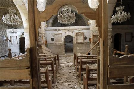 Debris lie inside a damaged church in Mar Bacchus Sarkis monastery, in Maloula village, northeast of Damascus
