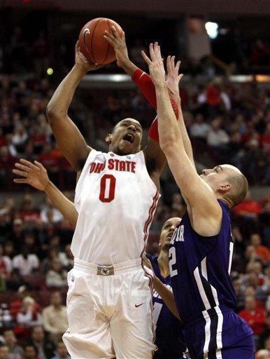 Ohio State's Jared Sullinger (0) shoots over Northwestern's Luka Mirkovic (12) during the first half of an NCAA college basketball game, Wednesday, Dec. 28, 2011, in Columbus, Ohio. (AP Photo/Terry Gilliam)