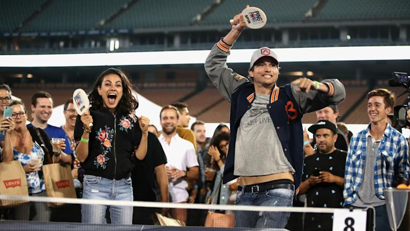 mila kunis and ashton kutcher get extremely competitive at charity
