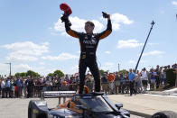 Pato O'Ward celebrates after winning the second race of the IndyCar Detroit Grand Prix auto racing doubleheader on Belle Isle in Detroit, Sunday, June 13, 2021. (AP Photo/Paul Sancya)