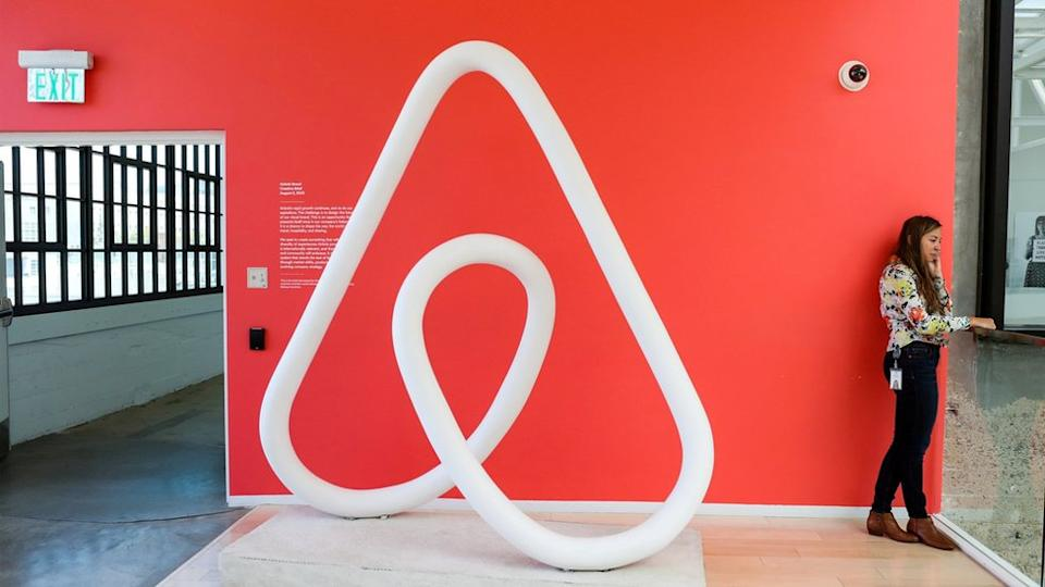 woman by Airbnb logo