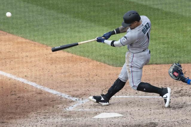 Miami Marlins' Isan Diaz hits a home run in his major league debut during the sixth inning of a baseball game against the New York Mets, Monday, Aug. 5, 2019, in New York. (AP Photo/Mary Altaffer)