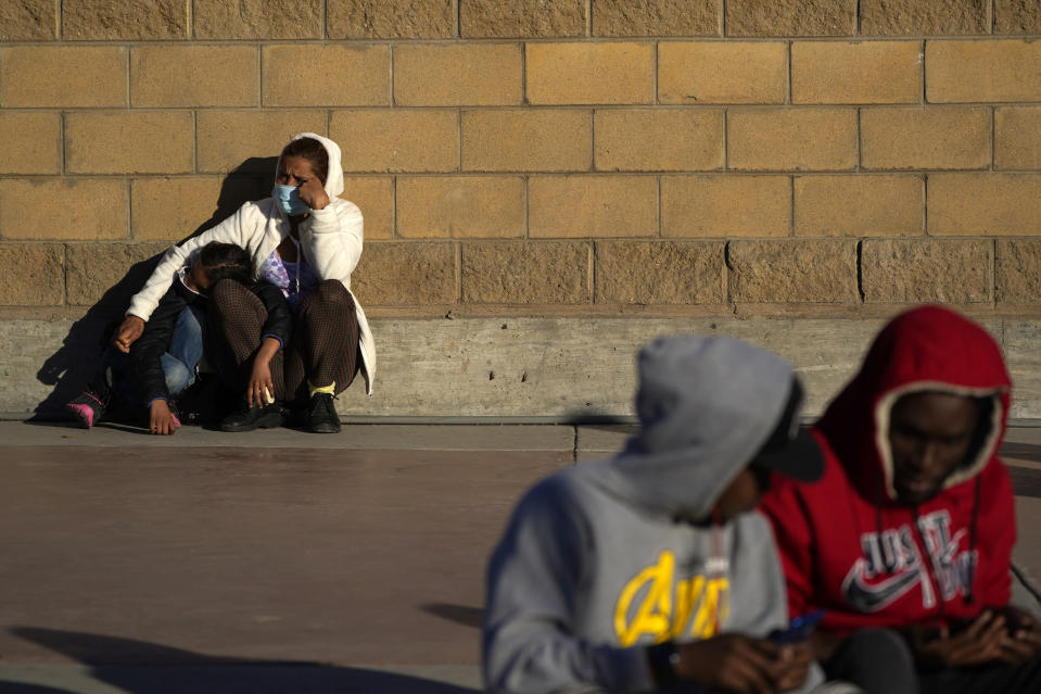 Asylum seekers wait for news of policy changes at the border, Friday, Feb. 19, 2021, in Tijuana, Mexico. After waiting months and sometimes years in Mexico, people seeking asylum in the United States are being allowed into the country starting Friday as they wait for courts to decide on their cases, unwinding one of the Trump administration's signature immigration policies that President Joe Biden vowed to end. (AP Photo/Gregory Bull)