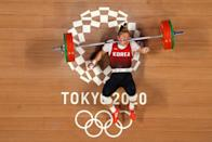 <p>TOKYO, JAPAN - AUGUST 01: Suhyeon Kim of Team South Korea competes during the Weightlifting - Women's 76kg Group A on day nine of the Tokyo 2020 Olympic Games at Tokyo International Forum on August 01, 2021 in Tokyo, Japan. (Photo by Chris Graythen/Getty Images)</p>