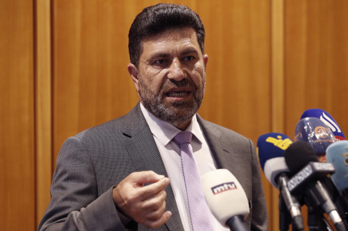 Lebanon's Energy Minister Raymond Ghajjar, speaks to journalists upon his arrival from Iraq at Rafik Hariri international airport after he signed an agreement with the Iraqi government, in Beirut, Lebanon, Saturday, July 24, 2021. Lebanon signed a deal Saturday with Iraq that secures 1 million tons of Iraqi fuel for power plants as the small Mediterranean country struggles with a crippling cash and energy crisis, according to Lebanese and Iraqi media. (AP Photo/Hussein Malla)