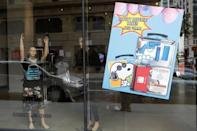 """The art installation by artist WhIsBe titled """"Back to School Shopping"""" to illustrate the dangers of gun violence in schools is seen through a window at a gallery in New York City"""