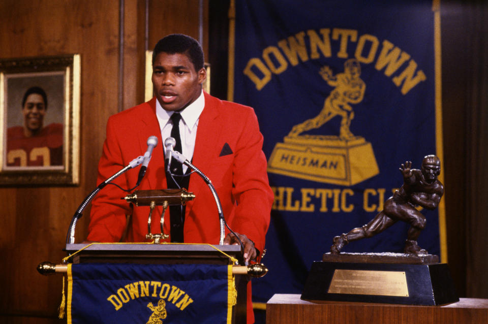 (Original Caption) New York, New York: Georgia running back Herschel Walker, the most dominant player in college football the last three years, adds the Heisman Trophy to his treasure chest 11/4. Walker became only the sixth junior to win the coveted bronze statue.