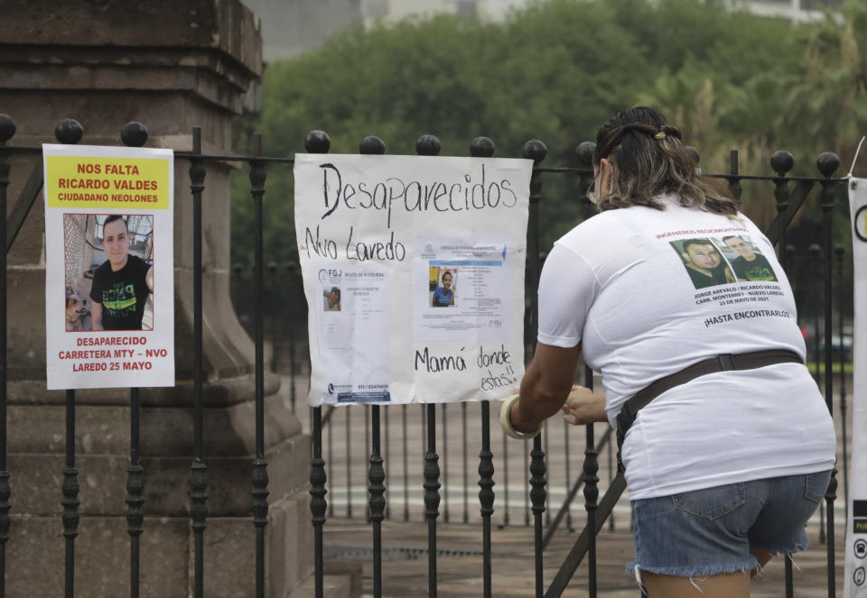 Family of Ricardo Valdes, who disappeared on the road on May 25, placed missing posters during a protest in Monterrey, Nuevo Leon state, Mexico, Thursday, June 24, 2021. As many as 50 people in Mexico are missing after they set off on simple highway trips between the industrial hub of Monterrey and the border city of Nuevo Laredo; relatives say they simply disappeared on the heavily traveled road, which has been dubbed 'the highway of death,' never to be seen again. (AP Photo/Roberto Martinez)