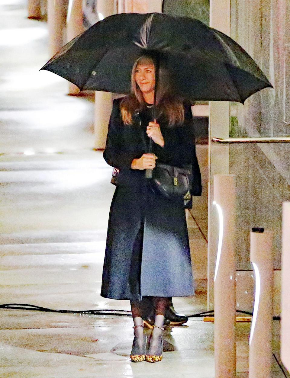 <p>Jennifer Aniston shoots scenes for <em>The Morning Show</em> on a rare rainy Thursday in L.A.</p>