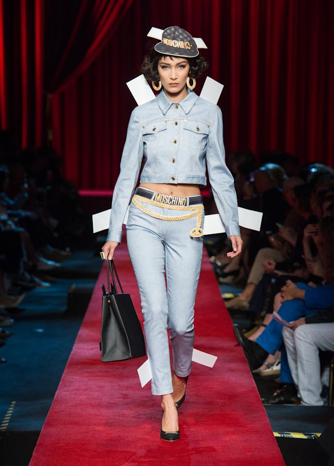 <p>Bella transformed into a living doll for Moschino's SS17 collection. <i>[Photo: Moschino]</i></p>
