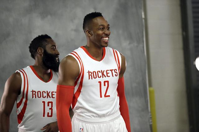 Houston Rockets' Dwight Howard (12) and James Harden (13) smile while posing for photographs during NBA basketball media day Monday, Sept. 29, 2014, in Houst