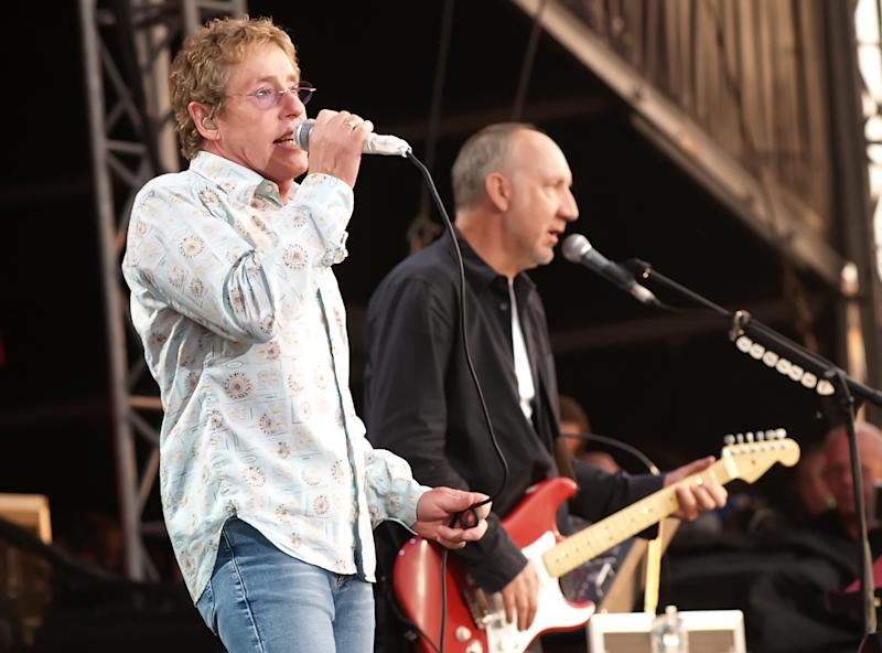 FILE - In this July 2, 2006 file photo, Roger Daltrey, left, and Pete Townshend of the Who perform at the Hyde Park music festival, London. ans still holding tickets for a canceled 1979 show in Rhode Island by British rock band The Who can finally use them. The Who's 1979 concert in Providence was canceled by then-Mayor Buddy Cianci after a stampede before a show in Cincinnati, Ohio, killed 11 people. The Who is now scheduled to play in Providence in February at the Dunkin Donuts Center, and arena General Manager Lawrence Lepore says the venue will honor tickets from the canceled 1979 show. He first made the offer on WPRO-AM on Thursday, July 19, 2012.(AP Photo/ Max Nash)