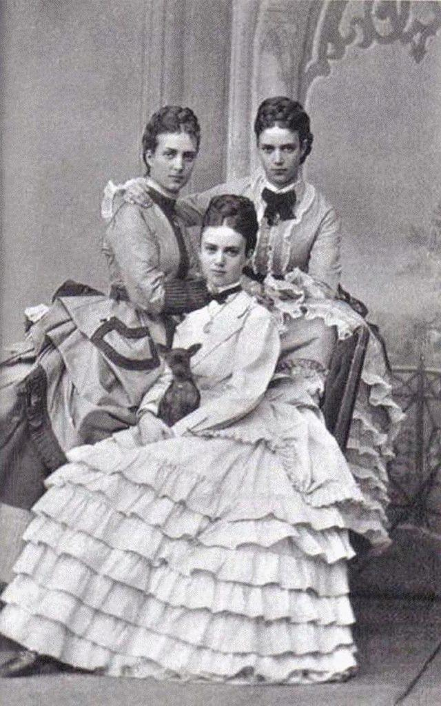 The Danish Princesses; Alexandra , Dagmar and Thyra, holding a Russian Toy dog