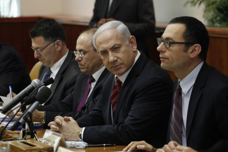 Israeli Prime Minister Benjamin Netanyahu, second right, chairs the weekly cabinet meeting at his office in Jerusalem, Sunday, March 25, 2012. (AP Photo/Gali Tibbon, Pool)